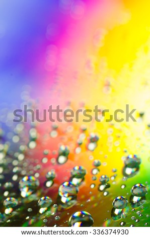 waterdrops on rainbow colors background selective focus - stock photo