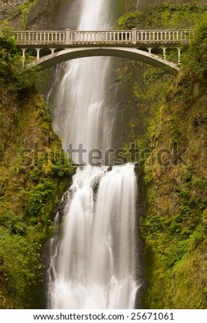 Waterfall and bridge - stock photo