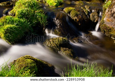 Waterfall and green overgrown (long exposure) - stock photo