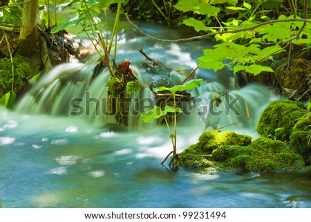 Waterfall and lake - stock photo