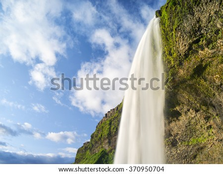 waterfall and sky with clouds in Iceland