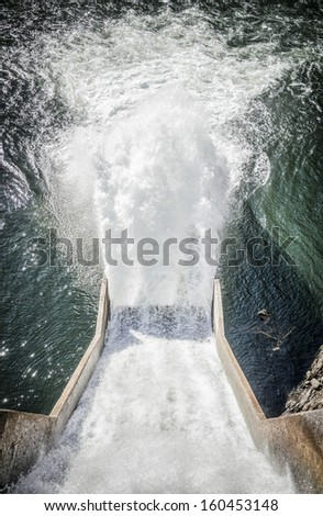 waterfall at a reservoir - stock photo