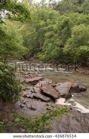 Waterfall at mill dam - stock photo