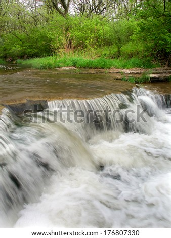 Waterfall at the Des Plaines Conservation Area of northern Illinois - stock photo