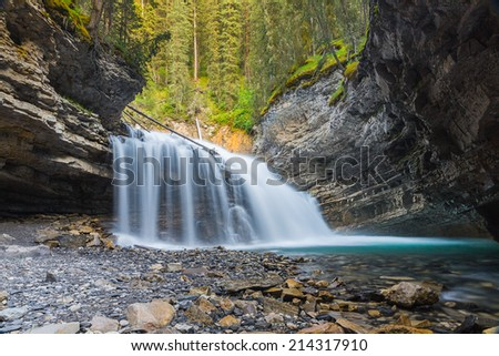 Waterfall at the Johnston Canyon in banff Canada  - stock photo