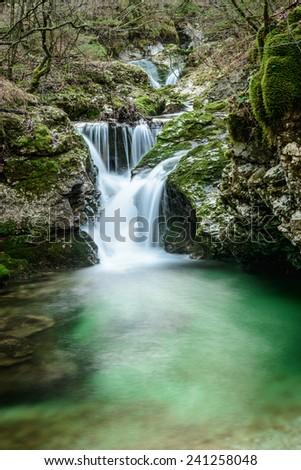 Waterfall at the Mostnica gorge near lake Bohinj in Slovenia.  - stock photo