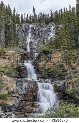 Waterfall cascading through the Rocky Mountains - Jasper National Park, Alberta, Canada - stock photo