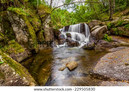 Waterfall during the autumn near the Queimadela Dam in the Municipality of Fafe. Portugal - stock photo