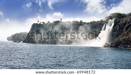 Waterfall, famous place of Antalya, Turkey. Clear sea and blue sky in summer - stock photo