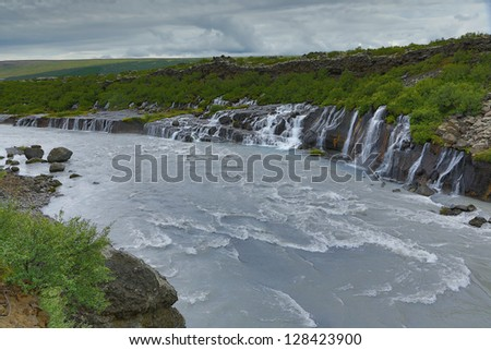 Waterfall Hraunfossar Iceland. - stock photo