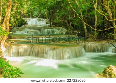 Waterfall  Huay Mae Kamin  National Park in Kanchanaburi Province, Flow is laminar in Thailand. - stock photo