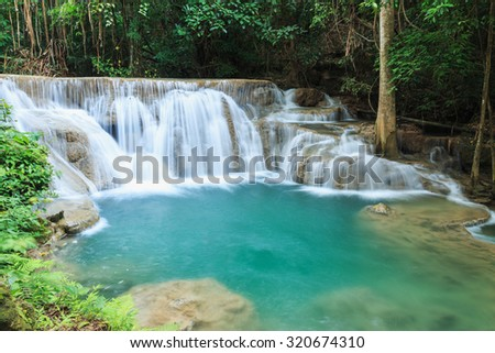 Waterfall Huay Mae Kamin, with dawn beautiful  in  forest deep  quiet of Thailand