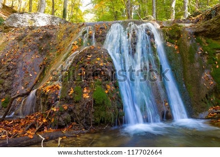 waterfall in a autumn mountains - stock photo