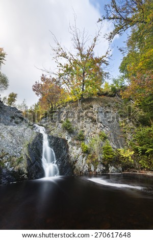 Waterfall in a canyon in the High Fens, Ardennes, Belgium with rotating vortex, long exposure shot - stock photo
