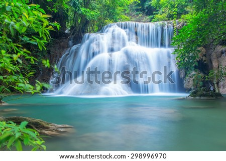 Waterfall in a forest on the mountain - stock photo
