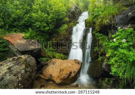 Waterfall in canyon. Beautiful natural landscape - stock photo