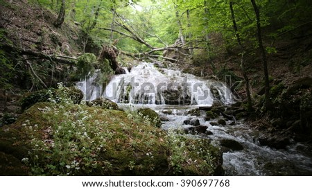 Waterfall in Crimean forest - stock photo