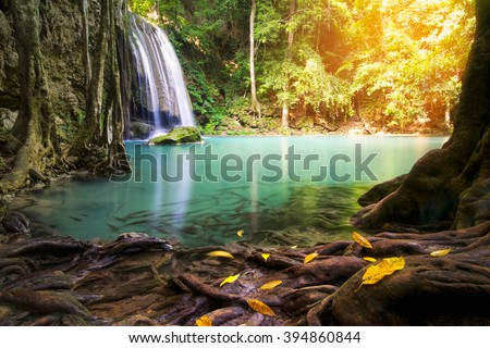 waterfall in deep forest  and wood pier - stock photo
