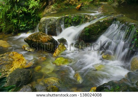 waterfall in deep forest at Kemensah in Kuala Lumpur ,Malaysia - stock photo