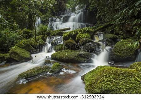 Waterfall in deep forest Mhundaeng waterfall or Man Daeng in phu hin rong kla national park, Phitsanulok province asia southeast asia Thailand - stock photo