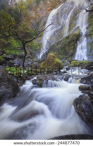 Waterfall in deep forest, national park - stock photo
