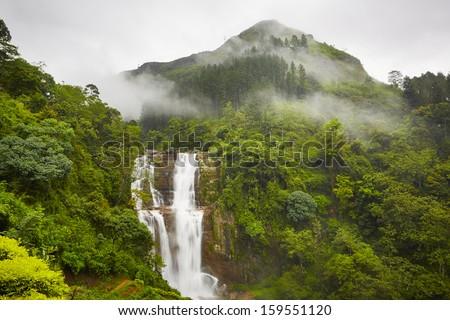 Waterfall in deep forest near Nuwara Eliya in Sri Lanka.  - stock photo