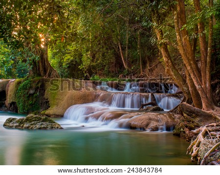 Waterfall in deep forest of national park, Thailand - stock photo