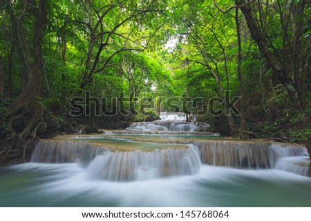 Waterfall in deep national forest - stock photo