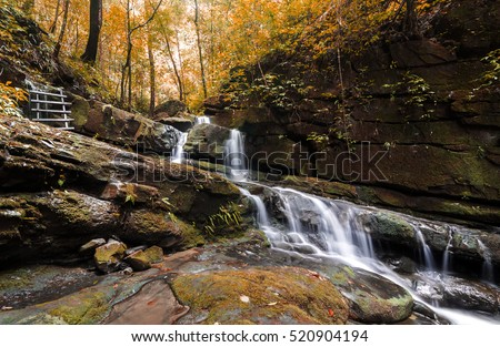 Waterfall in deep rain forest jungle