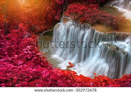 Waterfall in deep rain forest jungle (Huay Mae Kamin Waterfall in Kanchanaburi Province, Thailand) - stock photo