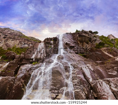 Waterfall in fjord Lysefjord - Norway - nature and travel background - stock photo