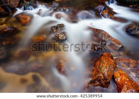 Waterfall in forest at Southern Thailand,long exposure-water motion blurred:Select focus with shallow depth of field:ideal use for background. - stock photo