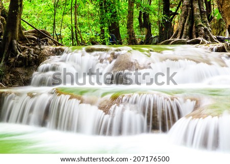 Waterfall in forest at Thailand. - stock photo