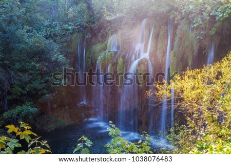 Waterfall in forest of Plitvice Lakes