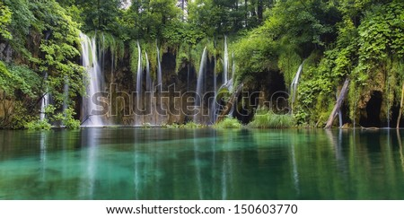 Waterfall in forest. Plitvice lakes, Croatia.UNESCO site. - stock photo