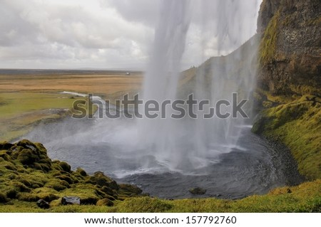Waterfall in Iceland taken from behind