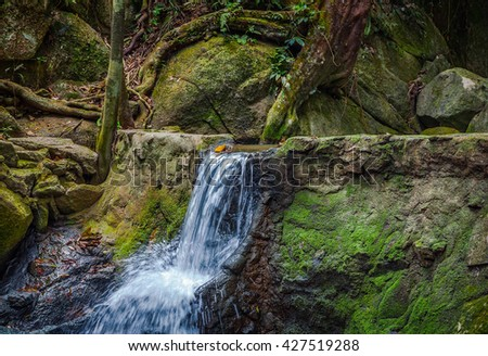 Waterfall in jungle in Thailand. - stock photo