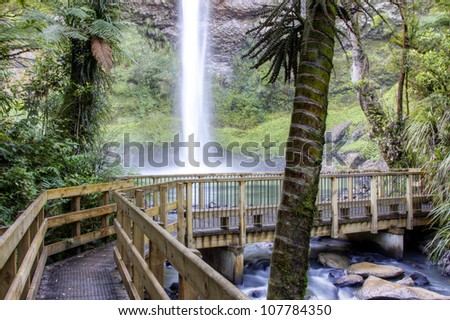 Waterfall in lush New Zealand forest - stock photo