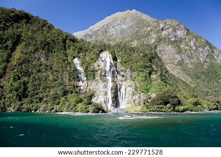 Waterfall in Milford Sound Bay. Milford Sound, New Zealand, Southern Island