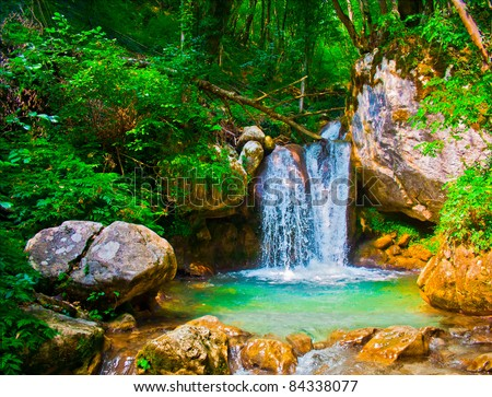 Waterfall in Montenegrian forest - stock photo