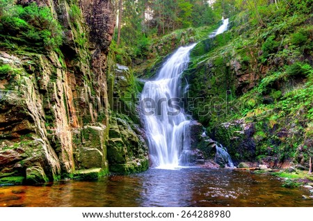 Waterfall in mountains. Famous Kamienczyk waterfall in the Karkonosze National Park in Sudety mountains, Poland - stock photo