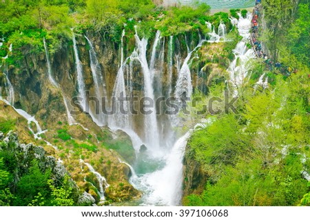 waterfall in Plitvice National Park, Croatia. Waterfall in a forest on the mountain - stock photo