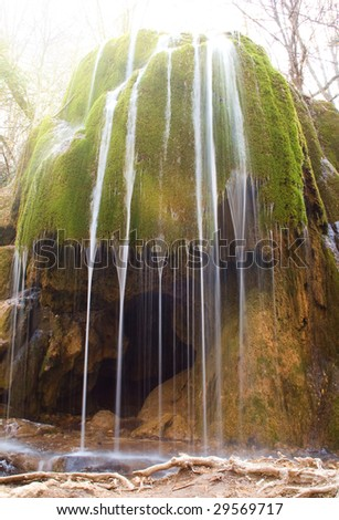 waterfall in rain forest at sunrise - stock photo