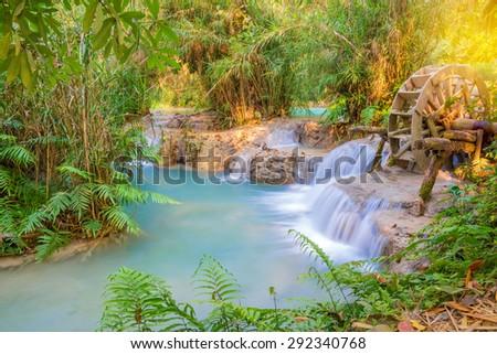 Waterfall in rain forest. (Tat Kuang Si Waterfalls at Luang prabang, Laos.) - stock photo