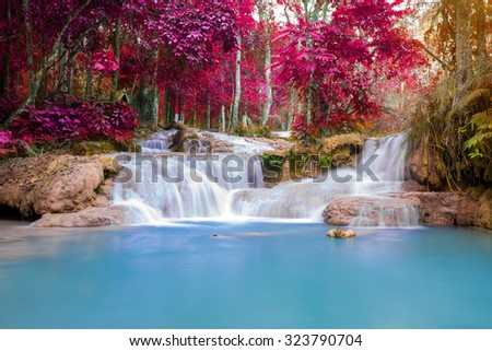 Waterfall in rain forest (Tat Kuang Si Waterfalls at Luang prabang, Laos.) - stock photo