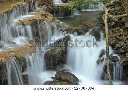 Waterfall  in spring season located in deep rain forest jungle - stock photo