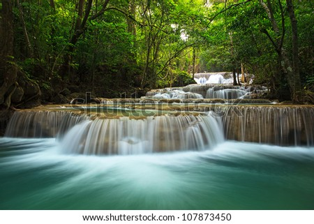 waterfall in thai national park. In the deep forest on mountain. - stock photo
