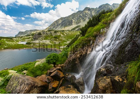 Waterfall in the Alps - stock photo