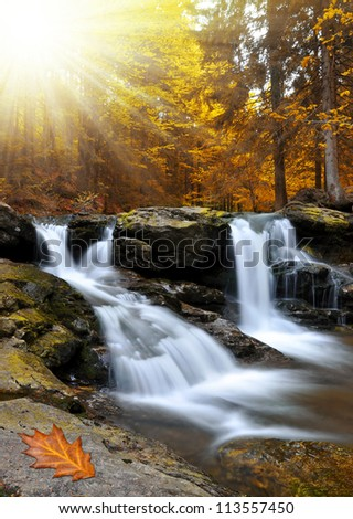 Waterfall in the autumn forest  in Czech Republic - stock photo