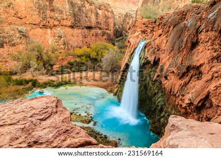 Waterfall in the canyon - stock photo